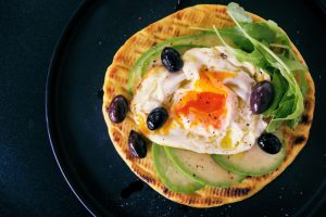 Tortilla with avocado and eggs and olives-Keephumanity research