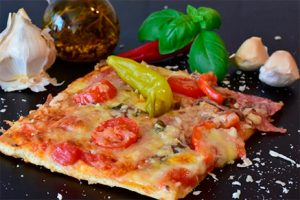 Red peppers pizza with garlic, mushroom, and olives- Little Italy recipe, San Francisco-Keephumanity research